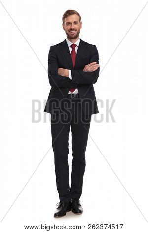 confident businessman standing on white background with arms folded and smiling, full length picture