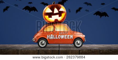 Halloween car delivering pumpkin against blue background