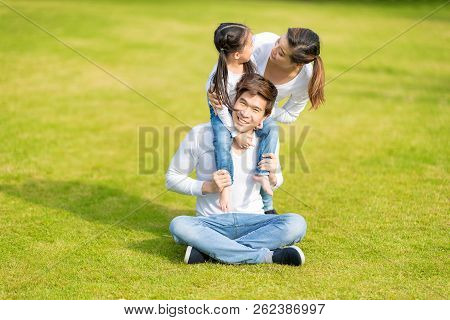 Cute Asian Girl On Neck Parents Big Happy Laughing And Run Around Together.happy Family Piggybacking