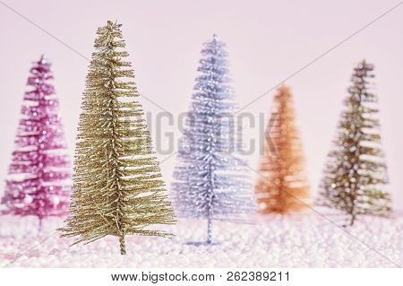 Retro Stylized Picture Of Miniature Christmas Trees, Selective Focus.