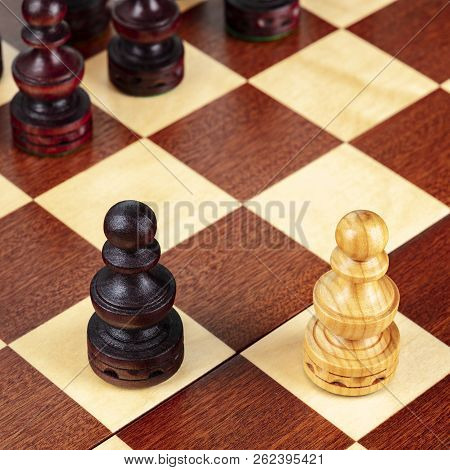 Two Pawns On A Chessboard, A Metaphor For A Conflict Or A Struggle