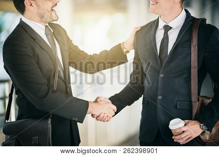 Businessmen Are Shaking Hands And Greetings To Work Together At Outdoor. Start New Projact Concept.