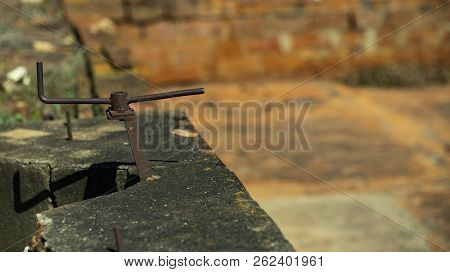 Iron Arrows In One Directions Are Isolated On A Blurred Background. Iron Object Looking Like An Arro