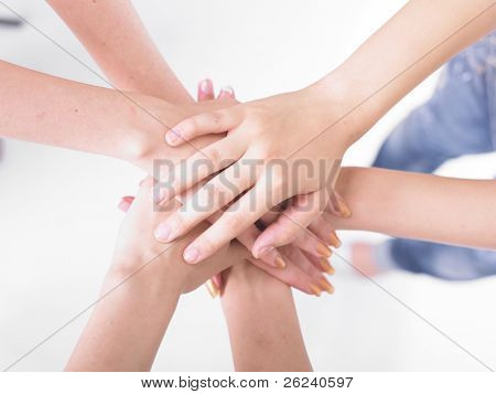 Business team join hands on white background