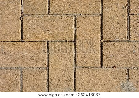 Sand Colored Brick Stone Pavement On The Ground For Street Road. Sidewalk, Driveway, Pavers, Pavemen