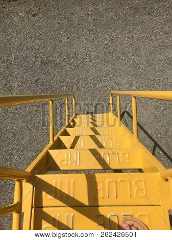 Downward view of yellow stairs