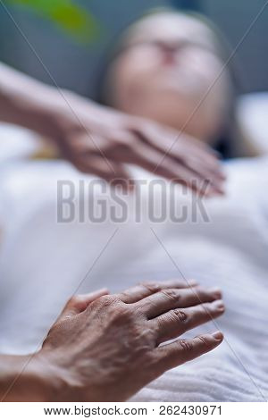 Hands At Reiki Healing Treatment
