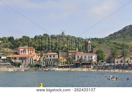 Collioure, France - September 5, 2018: Landscape Of Collioure And Its Beach Dominated By An Old Wind