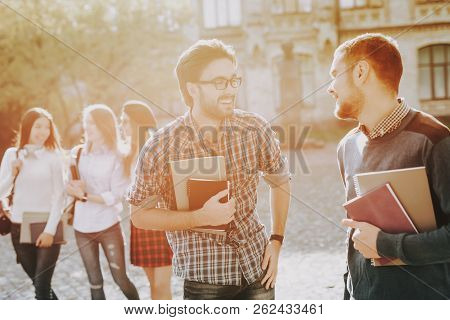 Happy. Students. Guys. Books. Standing In University. Good Mood. Intelligence. Standing Together. Ou