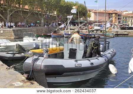 Collioure, France - September 5, 2018: Divers Preparing On A Boat In The Port Of Collioure To Go To