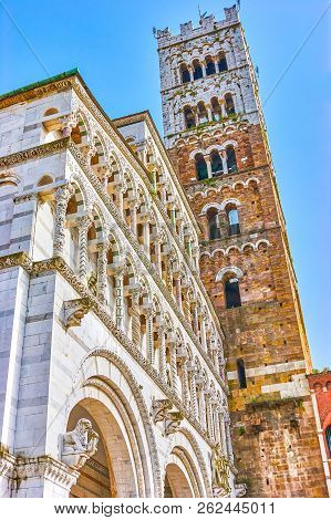 The Beautiful Frontage Of Lucca Duomo With Marble Columnar Arcades And Tall Two-coloured Bell Tower,
