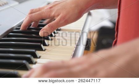 Musician Playing Synthesizer. The Musician Plays The Piano. Female Hands Play The Synthesizer.