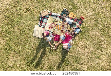 Aerial Drone View Of Happy Families Having Fun With Kids At Picnic Barbecue Party - Multiracial Happ