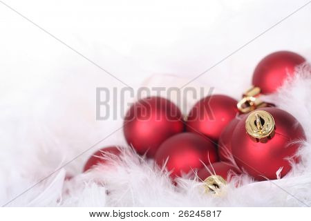 red ornaments in billowy feathers