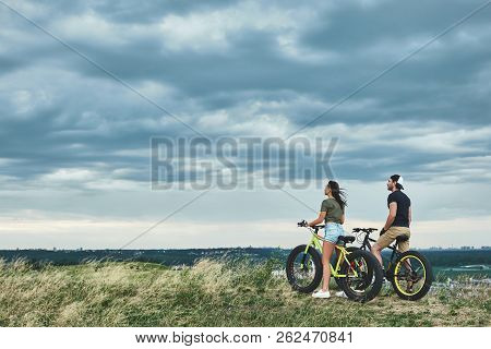 Afternoon Sunset With Mountainbike Couple. Rear View