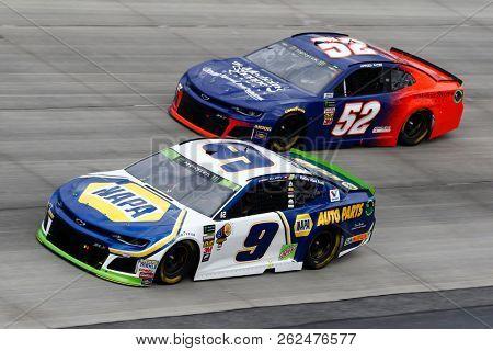 October 07, 2018 - Dover, Delaware, USA: Chase Elliott (9) and Harrison Rhodes (52) battle for position during the Gander Outdoors 400 at Dover International Speedway in Dover, Delaware.