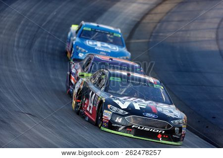 October 07, 2018 - Dover, Delaware, USA: Clint Bowyer (14) races through the field off turn two at  the Gander Outdoors 400 at Dover International Speedway in Dover, Delaware.