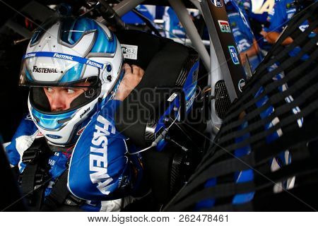 October 06, 2018 - Dover, Delaware, USA: Ricky Stenhouse, Jr (17) straps into his car to practice for the Gander Outdoors 400 at Dover International Speedway in Dover, Delaware.