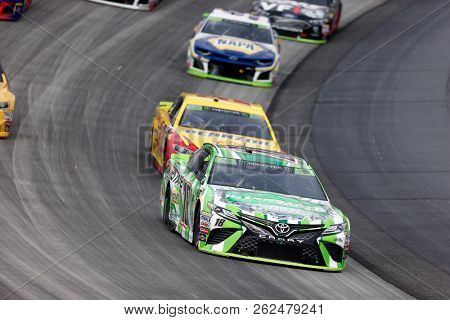 October 07, 2018 - Dover, Delaware, USA: Kyle Busch (18) races through the field off turn two at  the Gander Outdoors 400 at Dover International Speedway in Dover, Delaware.