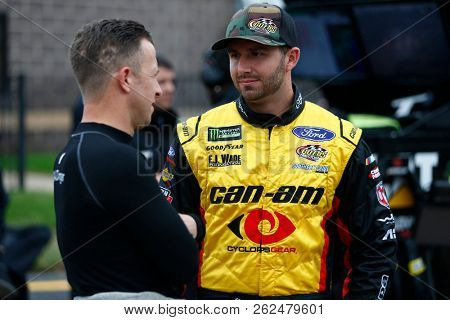 October 05, 2018 - Dover, Delaware, USA: Matt DiBenedetto (32) hangs out on pit road prior to qualifying for the Gander Outdoors 400 at Dover International Speedway in Dover, Delaware.