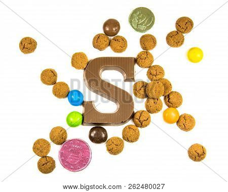 Flock Of Pepernoten Strooigoed With Chocolate Letter S, Top View On White Background For Annual Sint