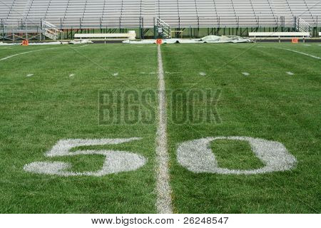 50 yard line with bleachers in the background