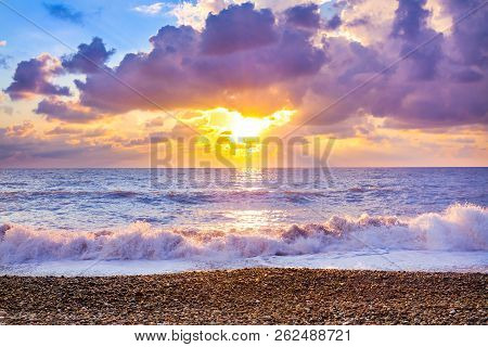 Beautiful Sea Landscape With A Sunset. Evening Purple Sky With Clouds Over Ocean. Sea Surf With Wave