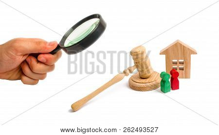 Magnifying Glass Is Looking At The Wooden Apartment House With Keys And A Judge Hammer On A White Ba