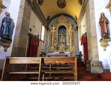 Trancoso, Portugal - June 21, 2018:  View Of The Main Chapel With A Beautifully Carved Woodwork Alta