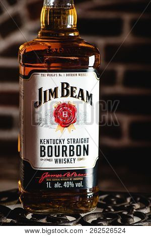 Moscow, Russia - April 24 2018: Jim Beam Bourbon Bottle On An Iron Grating. Brick Wall On Background
