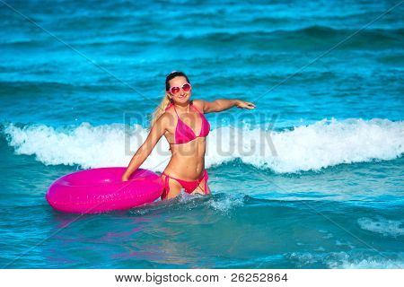 Woman with raft on the tropical beach