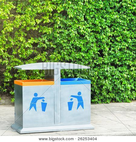 Two recycling bin on the beach. Environmental protection