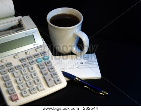 Calculator And Coffee Cup
