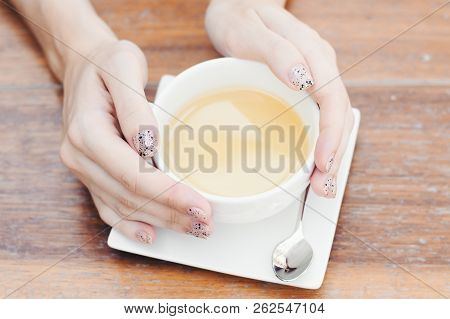 Female Hands With Manicure Holding A White Cup With Hot Drink. Green Tea. Herbal Beverage