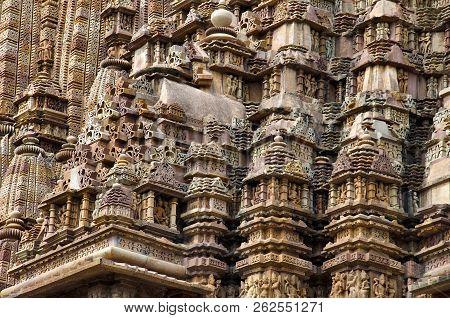 Kandariya Mahadev Temple, Carved Entrance Top With Deities In Niches And Spires Of Shikara, Western