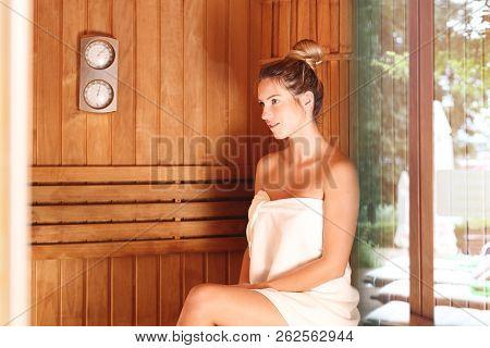 Sauna & Wellness  Beautiful Woman In The Sauna.