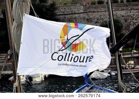 Collioure, France - September 5, 2018: Collioure City Flag Fluttering On The Harbor