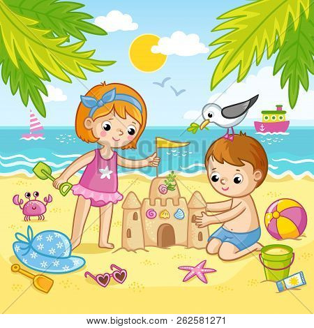 Boy And A Girl Are Building A Castle From The Sand. Children Playing On The Beach By The Sea.