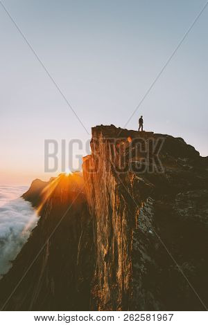 Traveler On Cliff Hiking Alone Sunset Mountain Adventure Outdoor Active Vacations Traveling Lifestyl