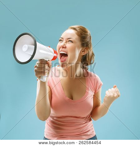 Woman Making Announcement With Megaphone At Blue Studio