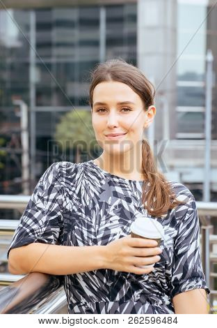 Woman Holding A Cup Of Coffee At Train Station,female With Positive Attitude Expressing Energy In Go