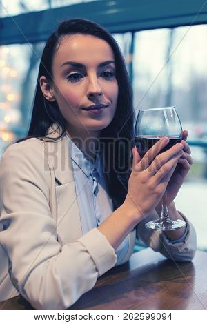 Relaxed Female Person Holding Bocal In Both Hands