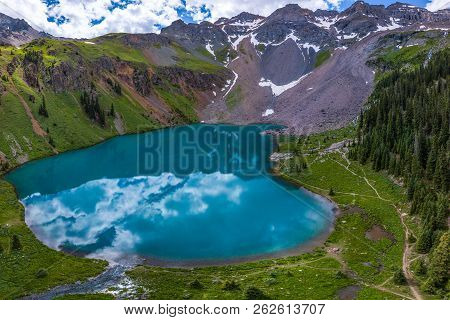 Blue Lake Near Near Ridgway Colorado With Dallas Peak And Gilpin Peak In The Background Bird's Eye V