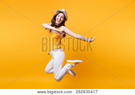 Portrait Of Excited Smiling Young Happy Jumping High Woman In Straw Summer Hat, Copy Space Isolated