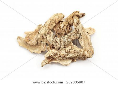 Chinese Herbal Medicine - Dang Gui Ginseng (angelica Sinensis) On White Background