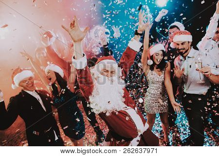 Man In Santa Claus Costume On New Year Party. Happy New Year. People Have Fun. Indoor Party. Celebra