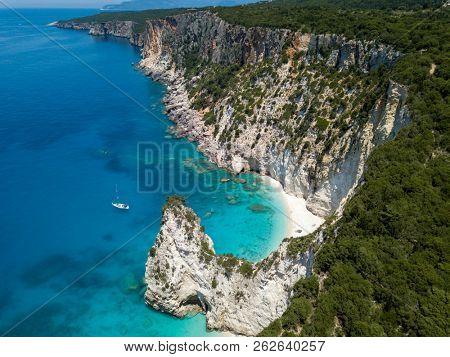 Aerial photo over greek island boat cliffs coastline landscape