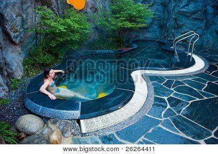 young woman at the hot thermal spa water pool of the Seorak Waterpia aquapark, Sokcho, South Korea