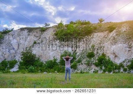 A Girl Looks At The Mountain In The Evening At Sunset. A Tourist Girl Looks At A Chalky Mountain, Ad