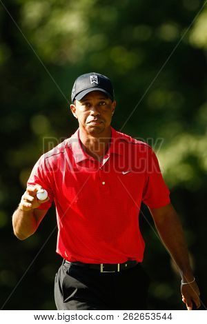 July 1, 2012; Bethesda, MD, USA; Tiger Woods waves to the crowd after the 13th green during the final round of the AT&T National at Congressional Country Club.